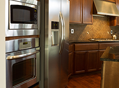 Silver appliances in kitchen